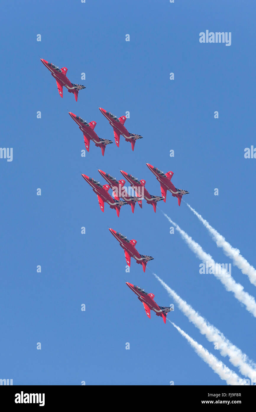 Royal Air Force (RAF) formation aerobatic display team the Red Arrows flying the British Aerospace Hawk T.1 trainer - Stock Image