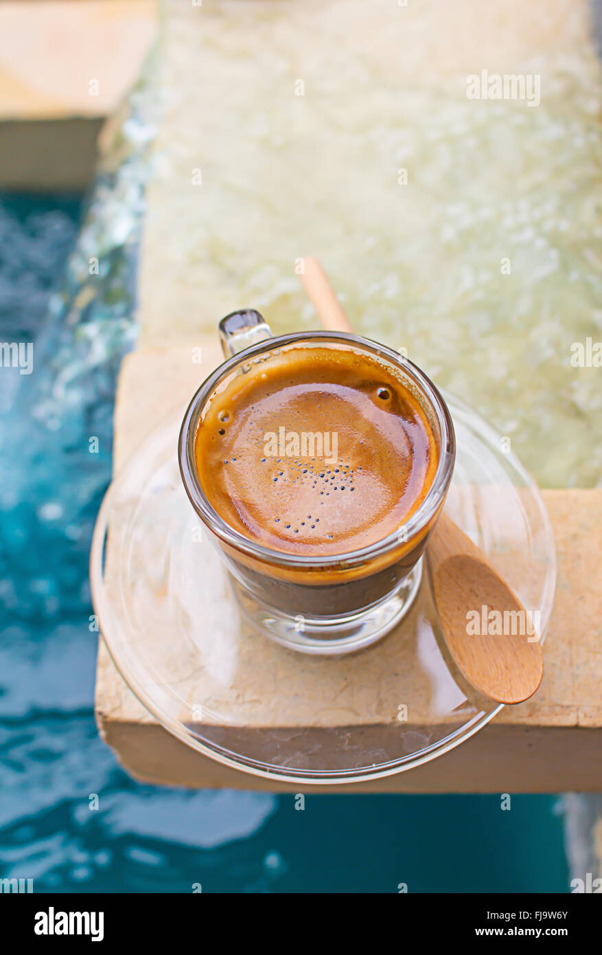 Espresso Coffee in a glass cup. - Stock Image
