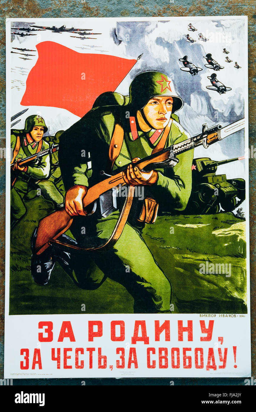Soviet russian patriotic propaganda poster from World War II with image of soldier going on attack with rifle - Stock Image
