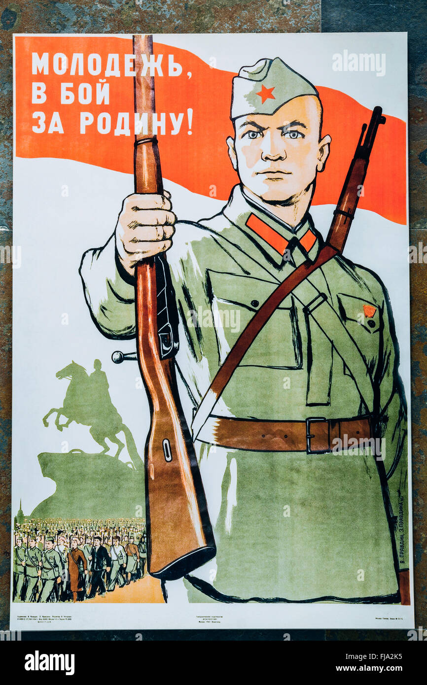 Soviet russian patriotic propaganda poster from World War II with image of soldier transferred rifle. Stock Photo