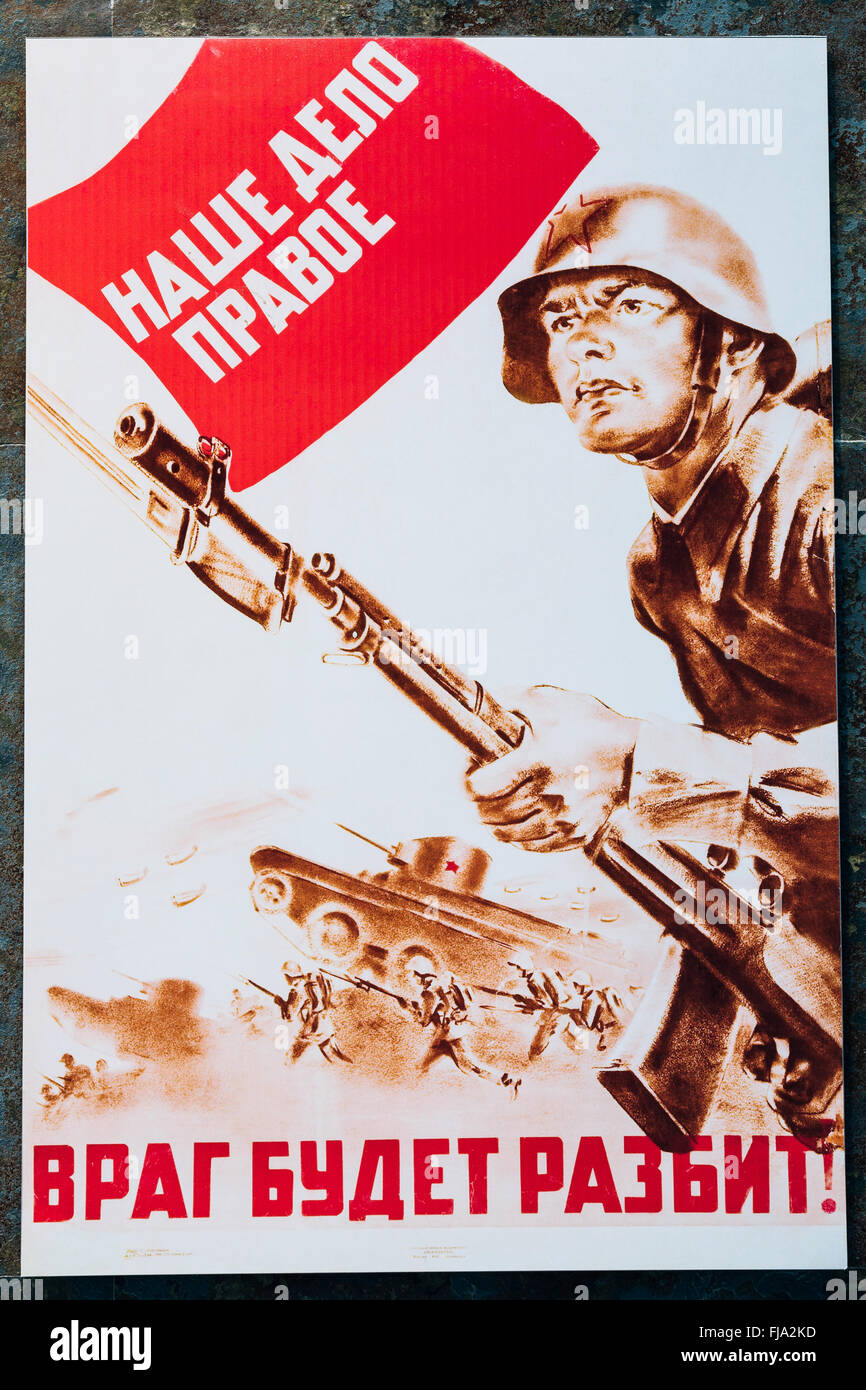 Soviet russian patriotic propaganda poster from World War II with image of soldier going on attack with rifle. - Stock Image