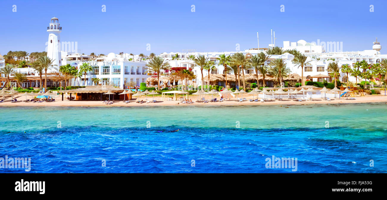 SHARM EL SHEIKH, EGYPT - FEBRUARY 25, 2014: Coastal lighthouse and hotel on the beach, a luxury vacation for tourists - Stock Image