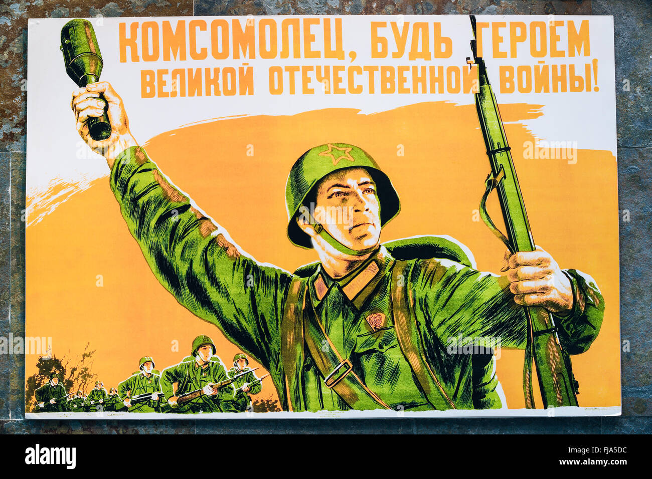 Soviet russian patriotic propaganda poster from World War II with image of soldier going on attack with rifle and - Stock Image