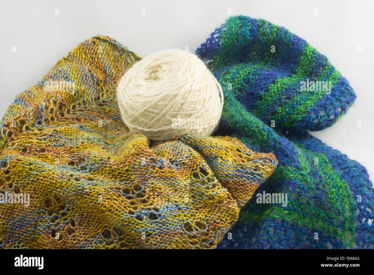 knitted items and ball of wool - Stock Image