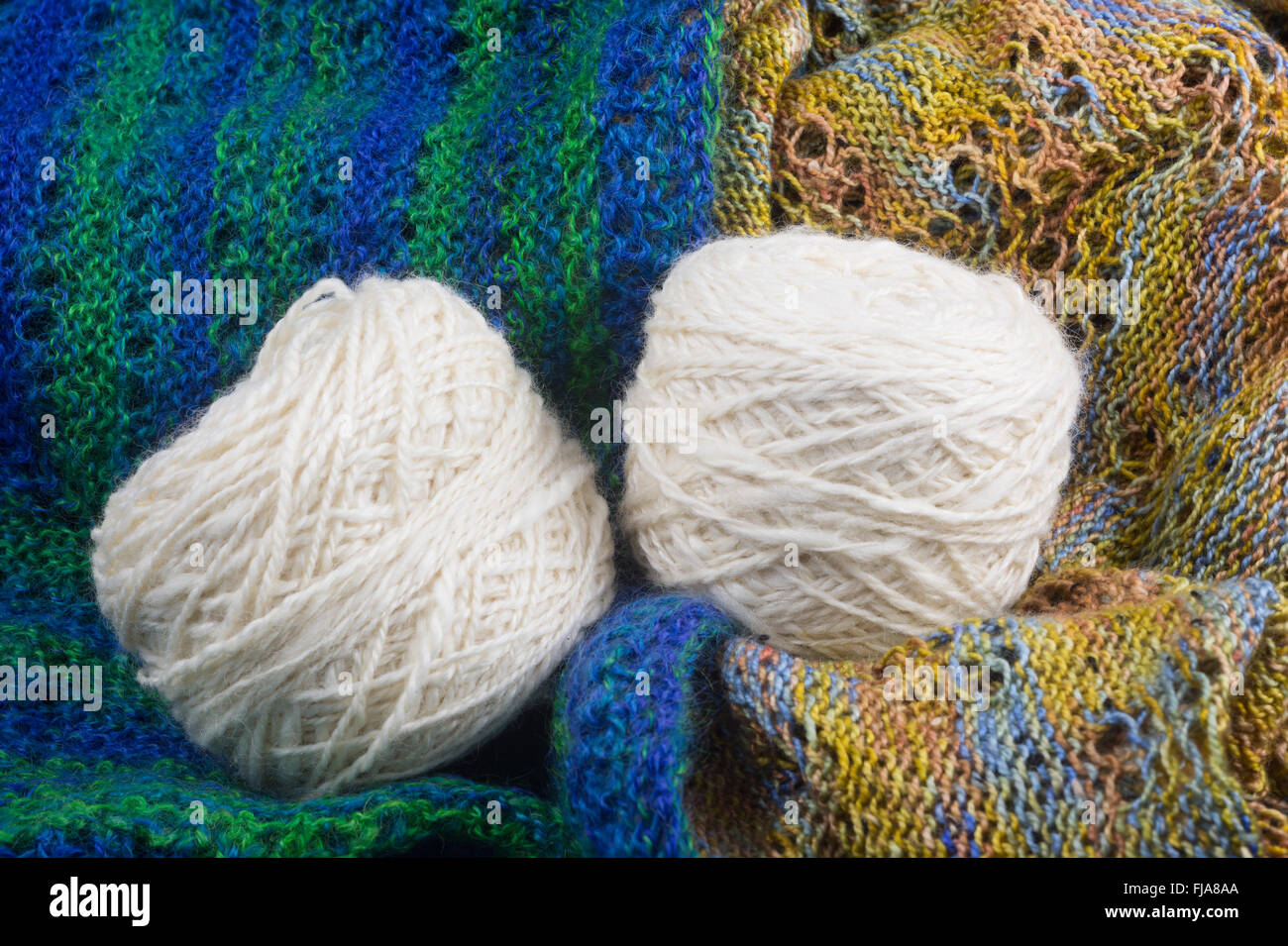 knitted items and balls of wool - Stock Image