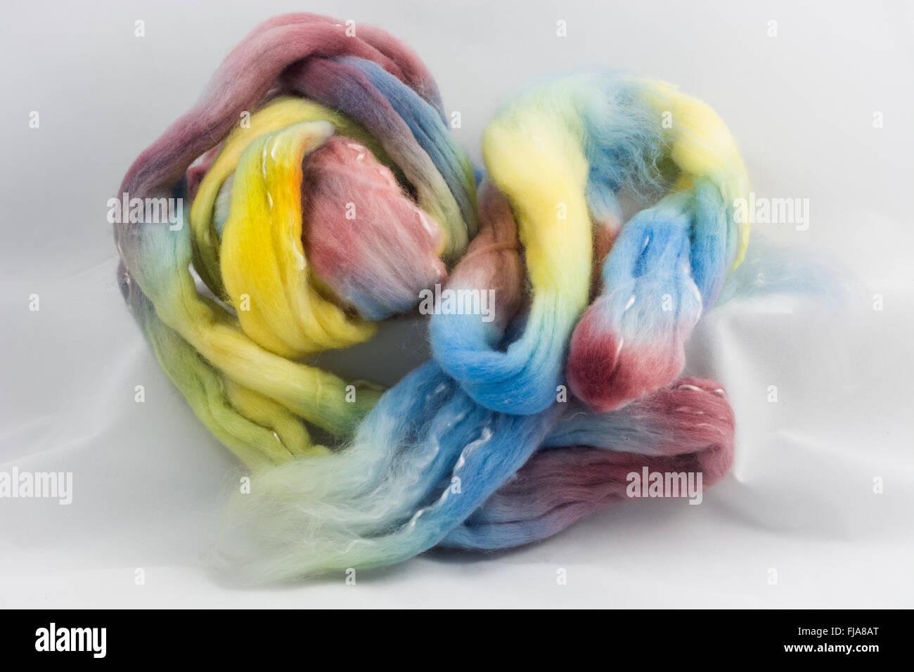 Coloured hand spun wool - Stock Image