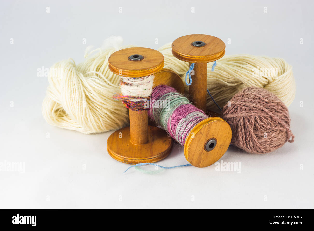 Skeins of wool and bobbins - Stock Image