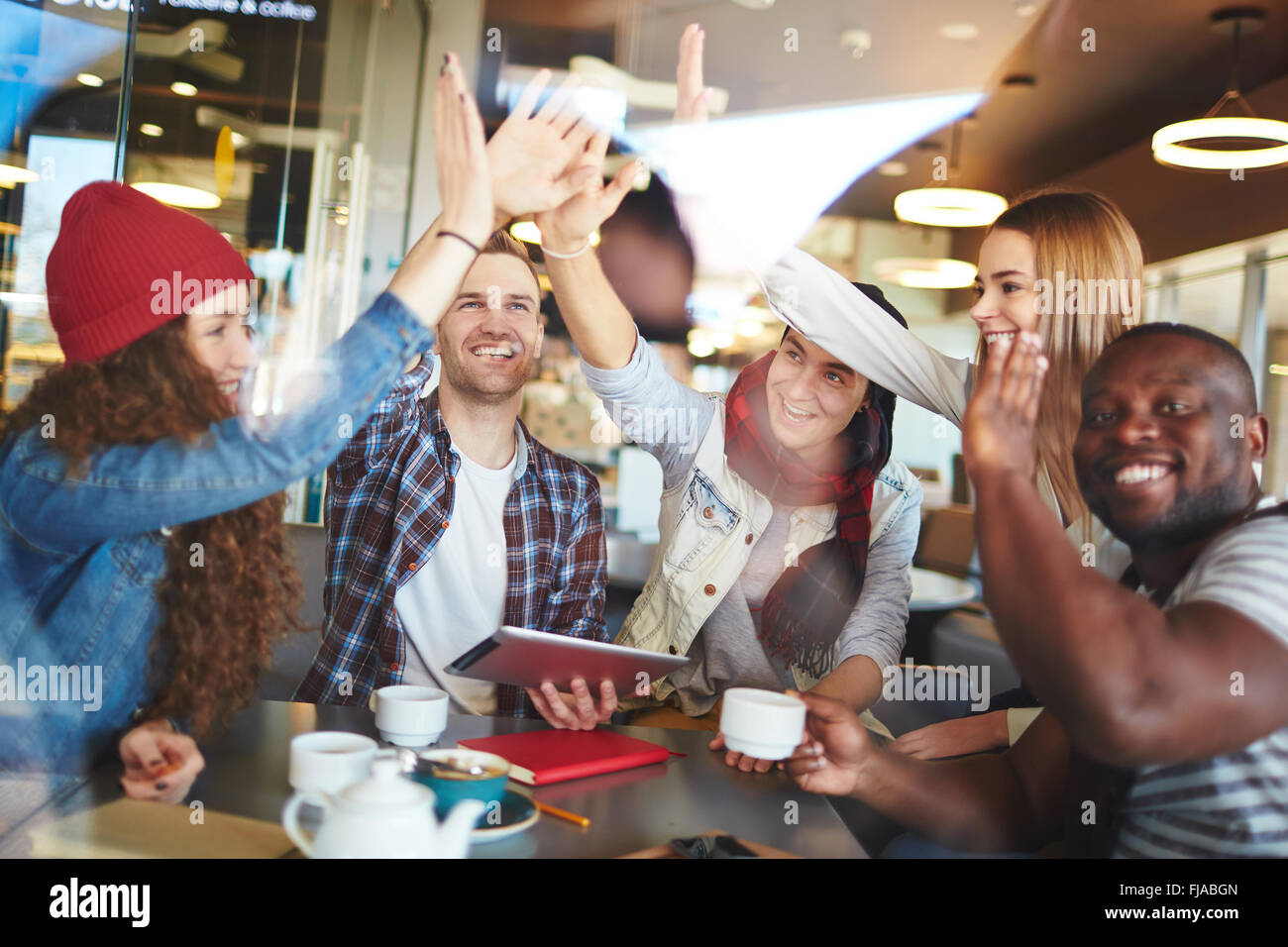 Group of young friends enjoying spending time together Stock Photo