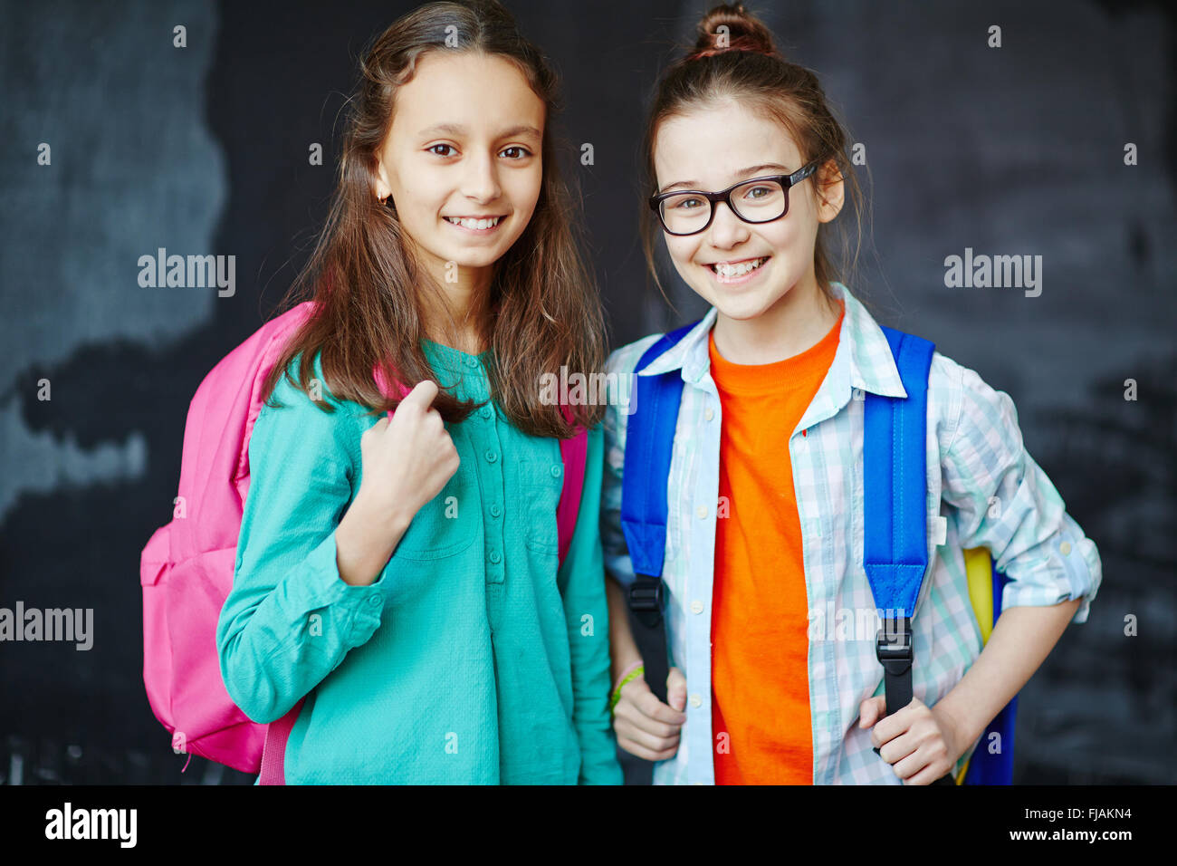 Portrait of two little girls smiling at camera - Stock Image