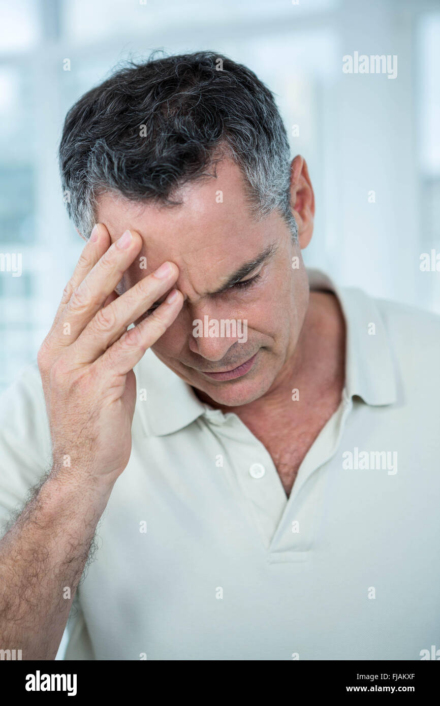 Man worried deeply about something - Stock Image