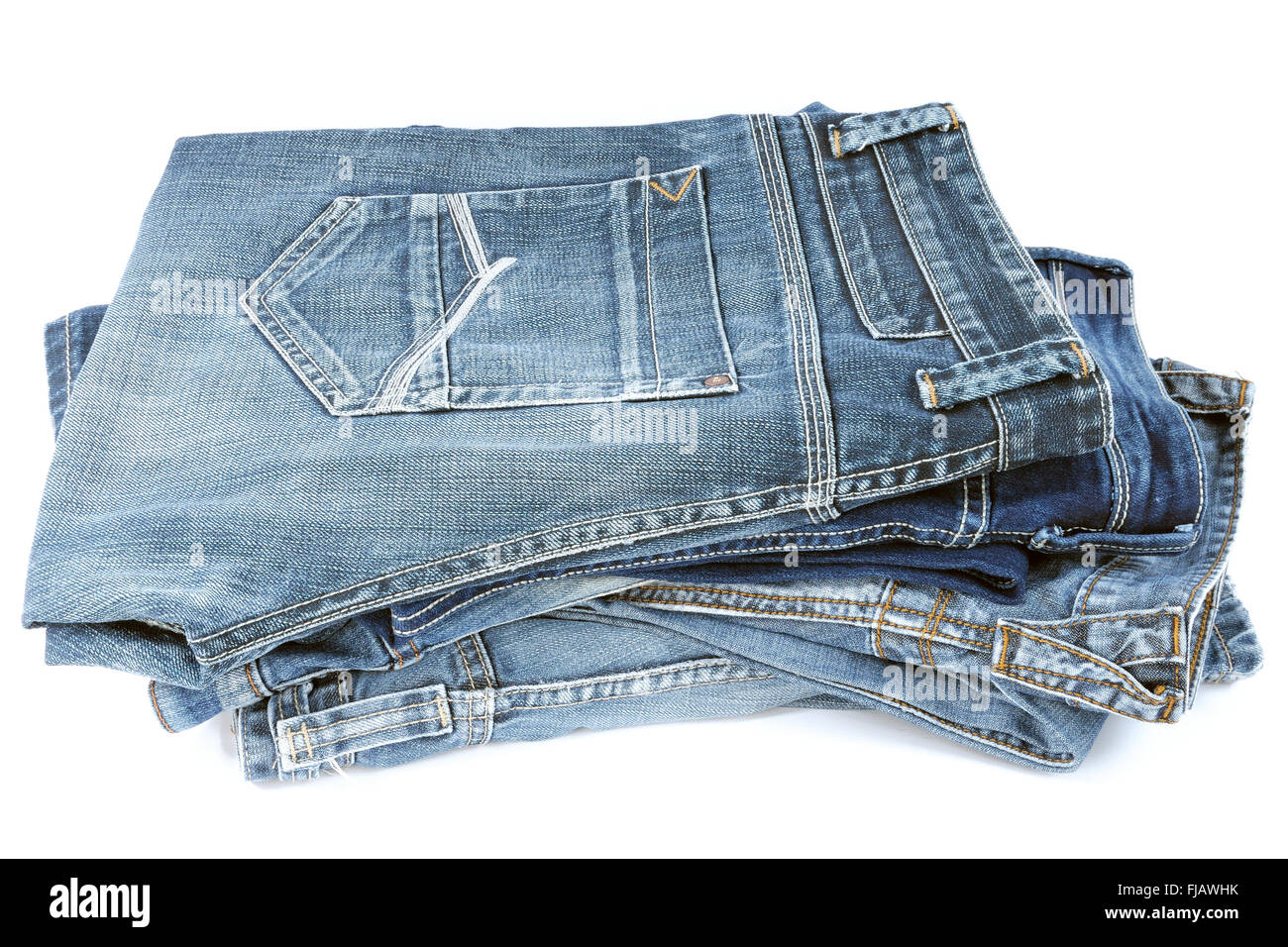 Various models of jeans for men stacked up and photographed in the studio - Stock Image
