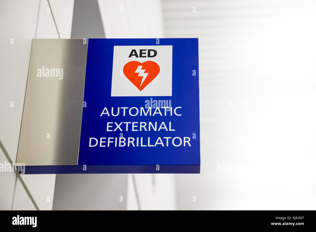 AED Automated External Defibrillator Sign at an airport. Stock Photo