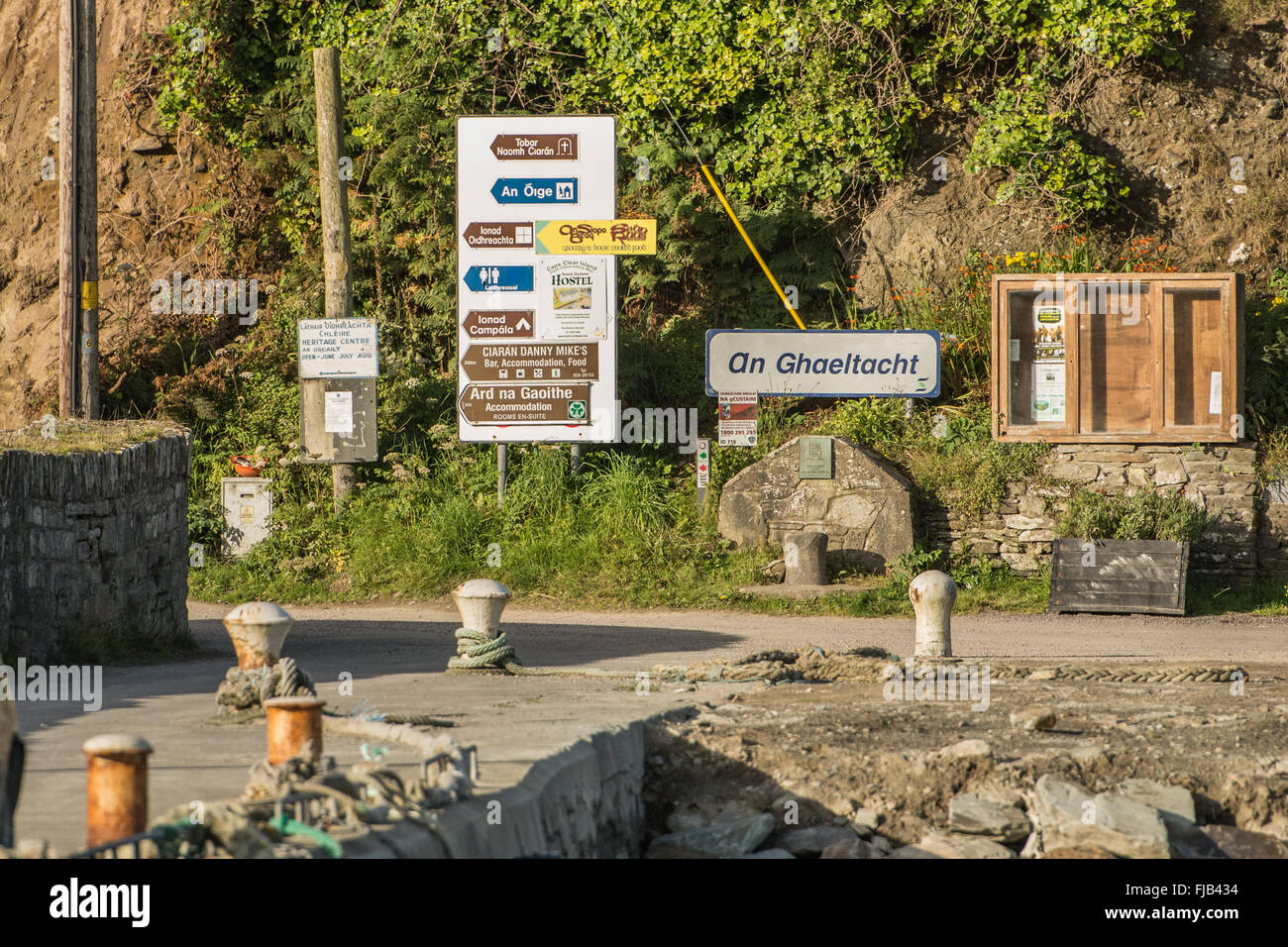 Signs in Irish in the Galetacht (Irish-speaking) island of Cape Clear off south-west Ireland - Stock Image