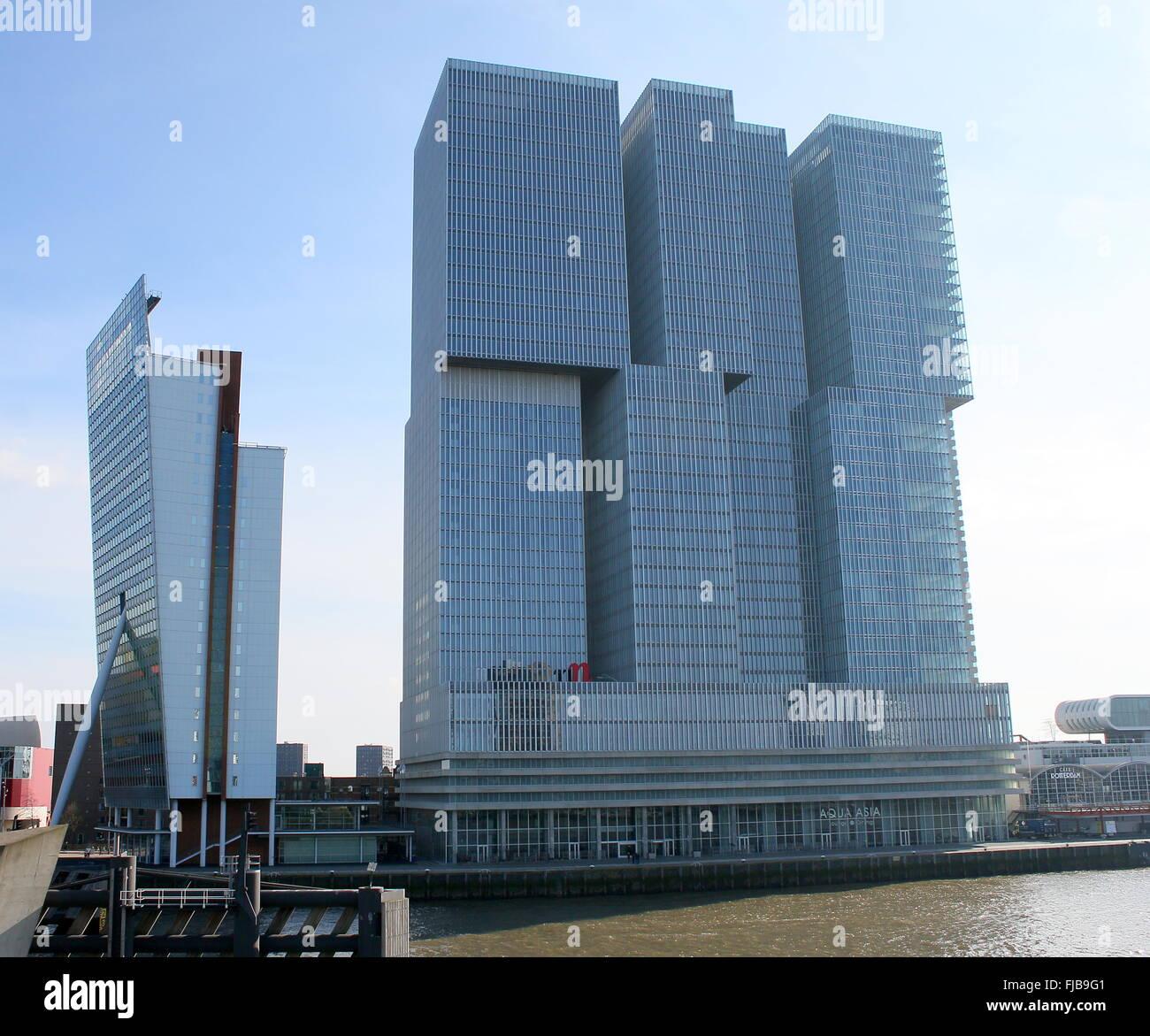 'De Rotterdam'  (2013) on Wilhelminapier in Rotterdam, design by Dutch architect  Rem Koolhaas, on left - Stock Image