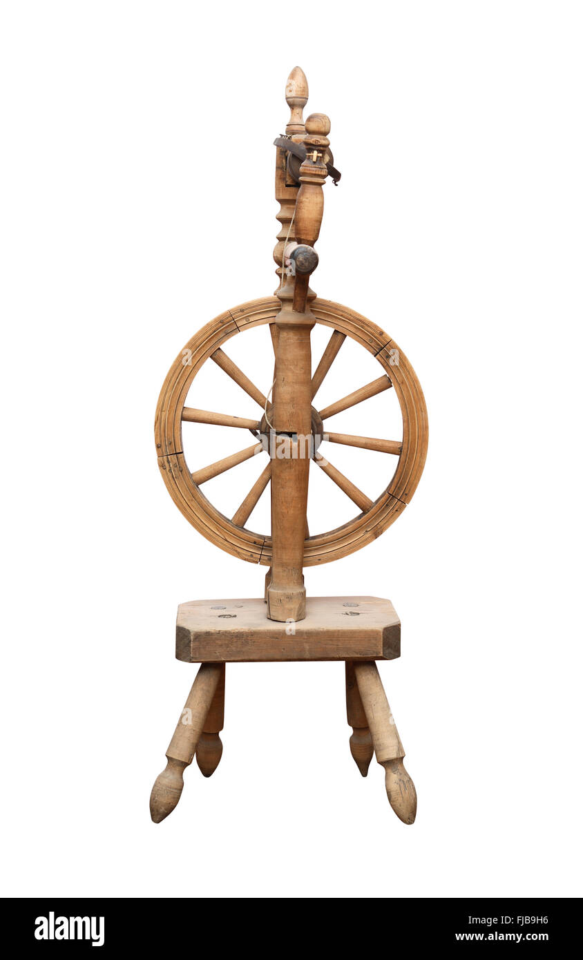 Nice ancient wooden spinning wheel on white background. Isolated with clipping path Stock Photo