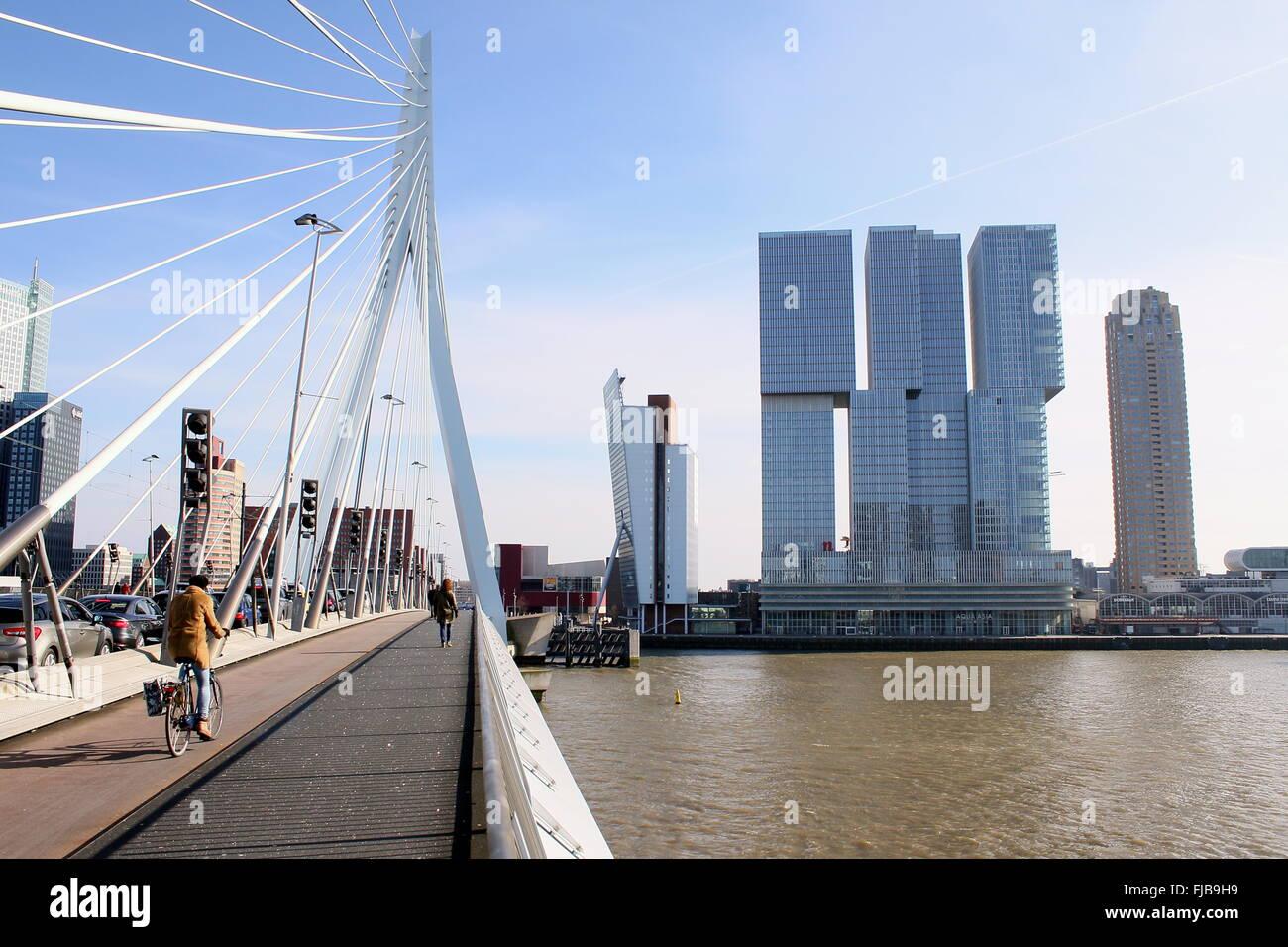 Erasmus bridge view on 'De Rotterdam' skyscraper (2013, Rem Koolhaas), flanked by Toren op Zuid (KPN tower) - Stock Image