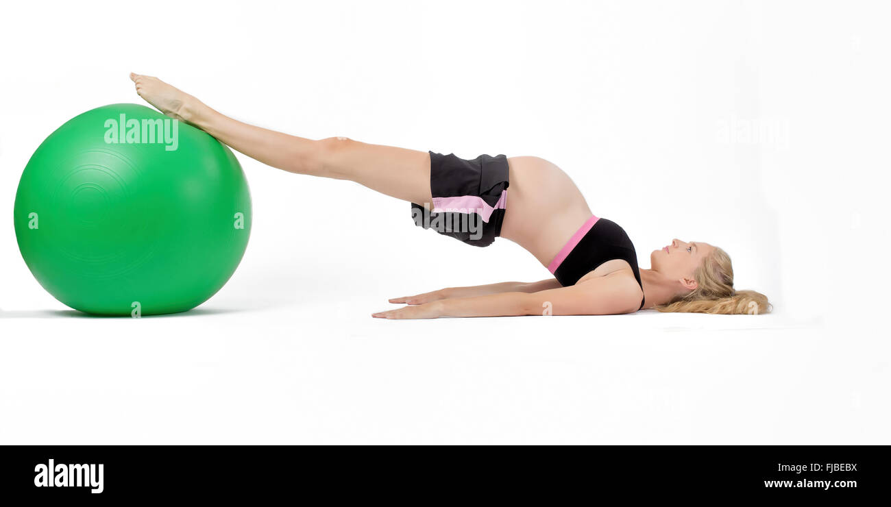 Pregnant Woman Using Yoga Ball Performing Hip Raise Exercise Stock Photo Alamy