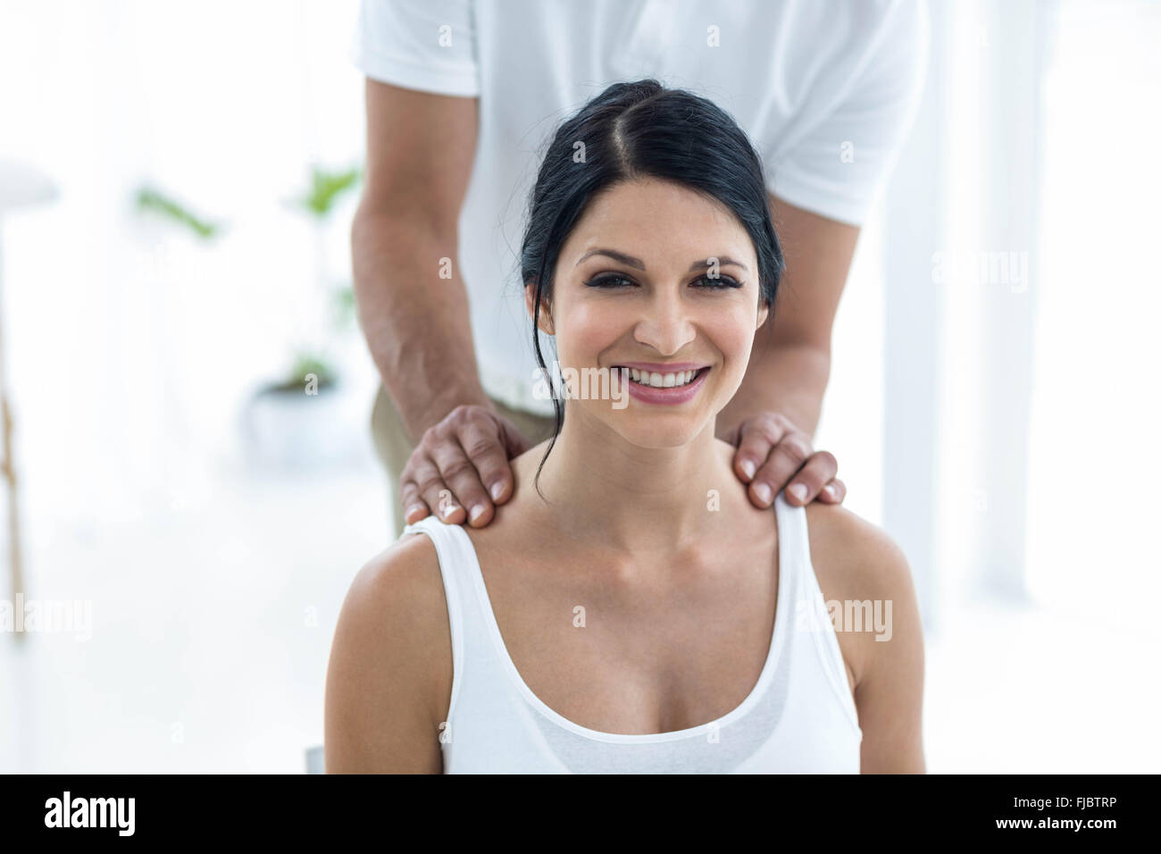 Doctor giving physiotherapy to pregnant woman - Stock Image