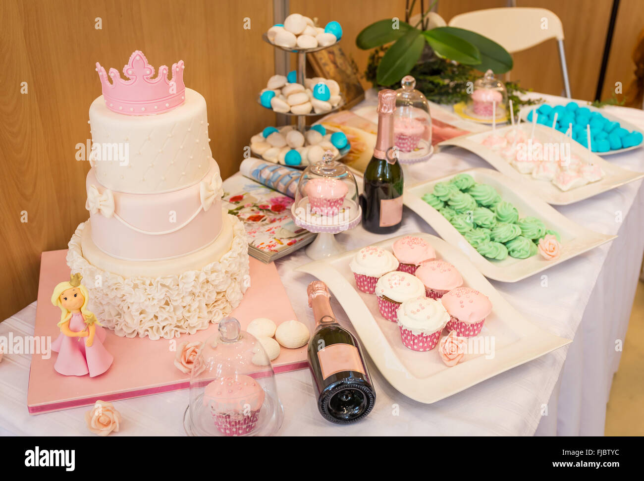 christening decorated table with cakes and sweets - Stock Image