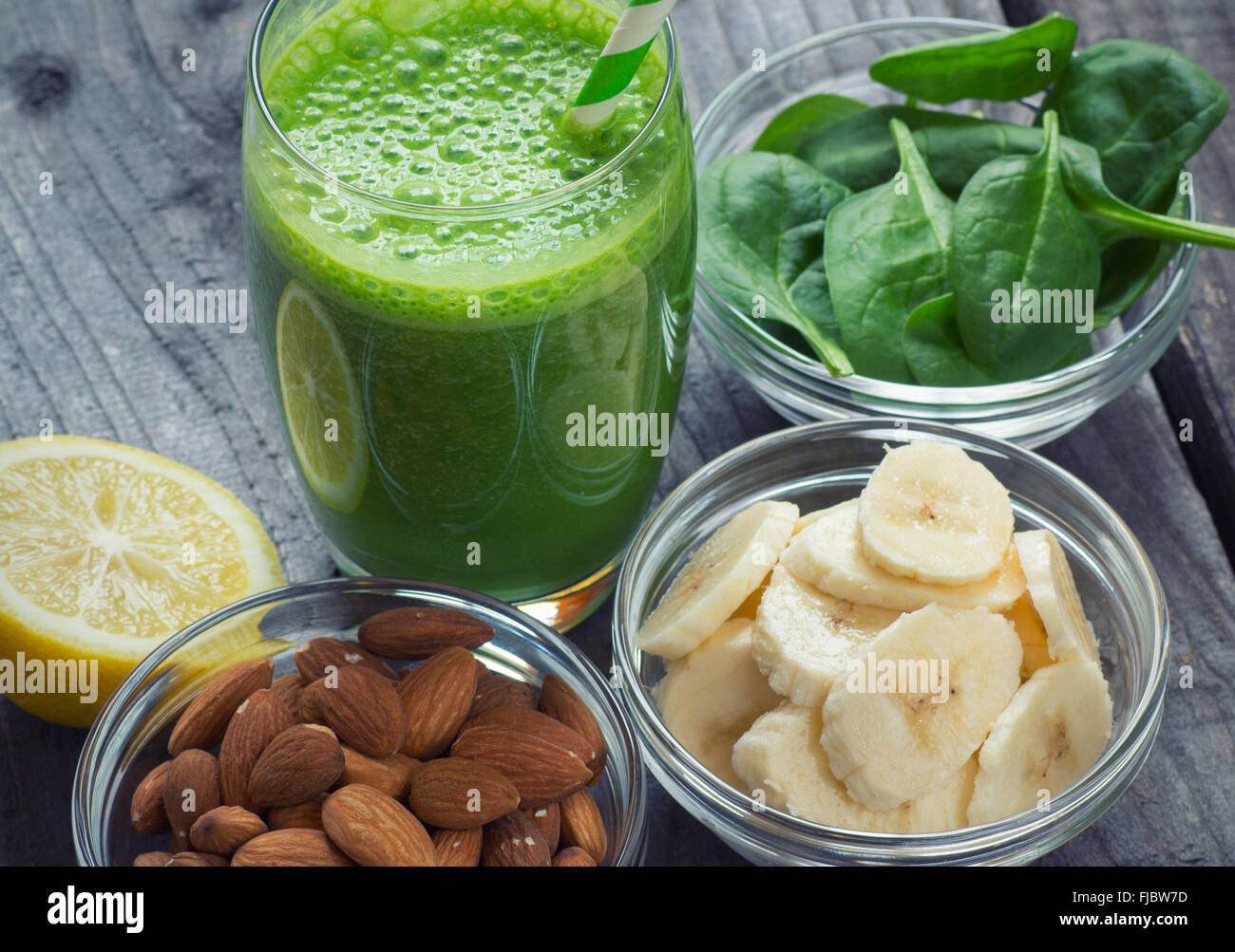 Green fresh healthy smoothie with fruits and vegetables Stock Photo