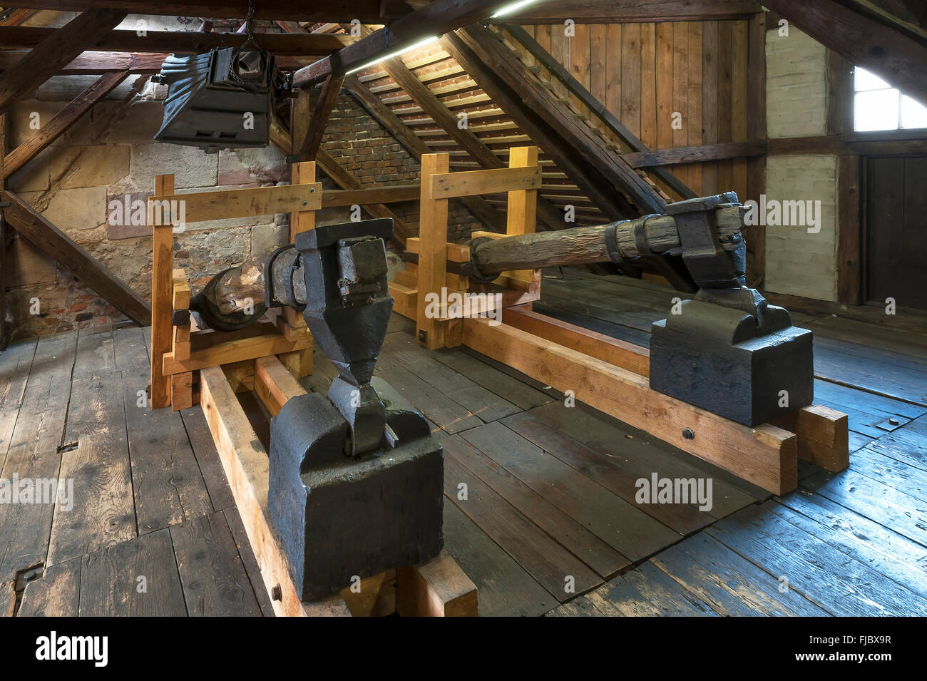 Old blacksmith's hammers and above an old bellow of 1875, Industrial Museum, Lauf, Middle Franconia, Bavaria, - Stock Image