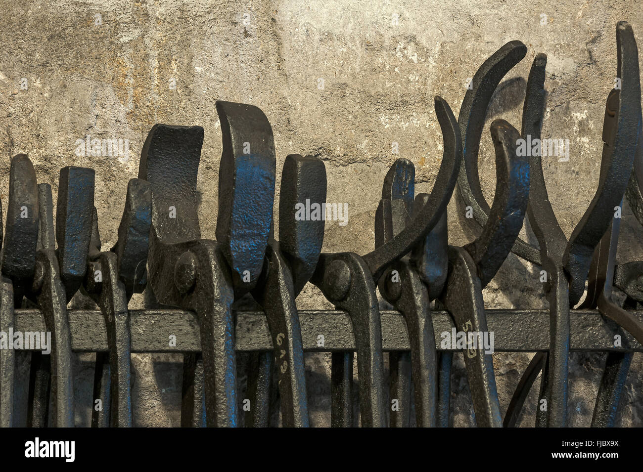 Forge tongs in a forge of the 19th century, Industrial Museum, Lauf, Middle Franconia, Bavaria, Germany - Stock Image
