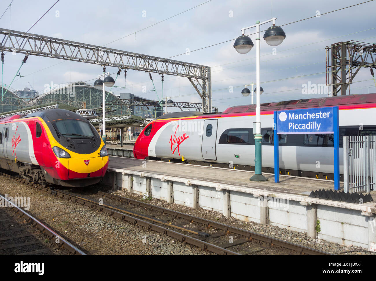 Virgin train at Manchester Piccadilly station, Manchester, England, UK - Stock Image
