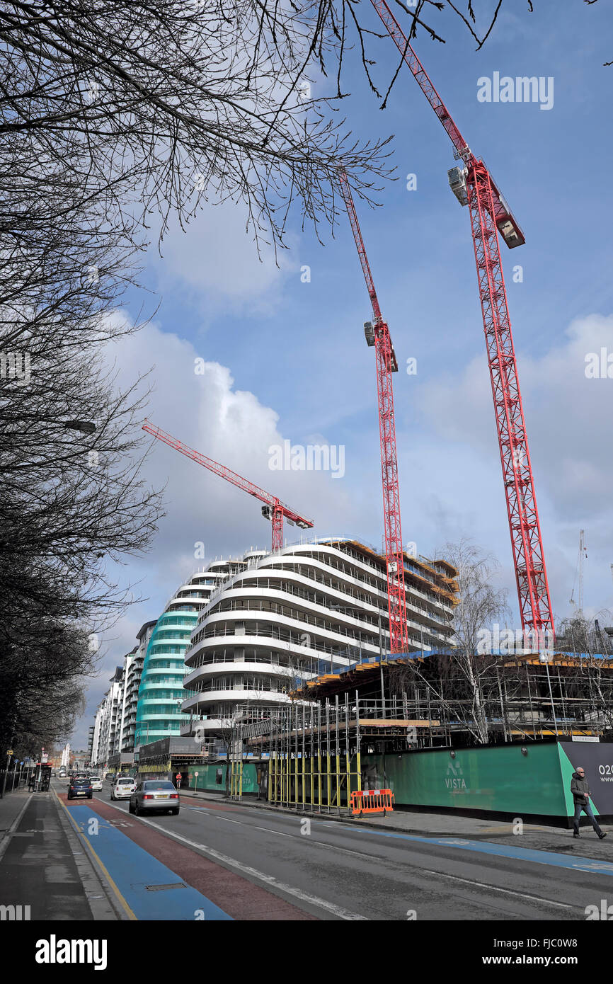 Cranes and new apartment buildings under construction on Queenstown Road in Wandsworth South London SW8  UK  KATHY - Stock Image