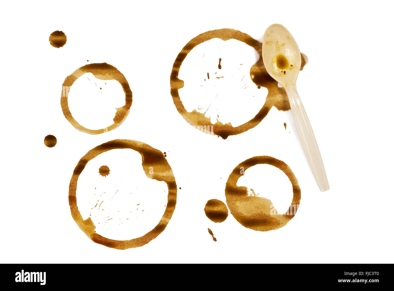 Coffee Cup Stains With Plastic Spoon - Stock Image