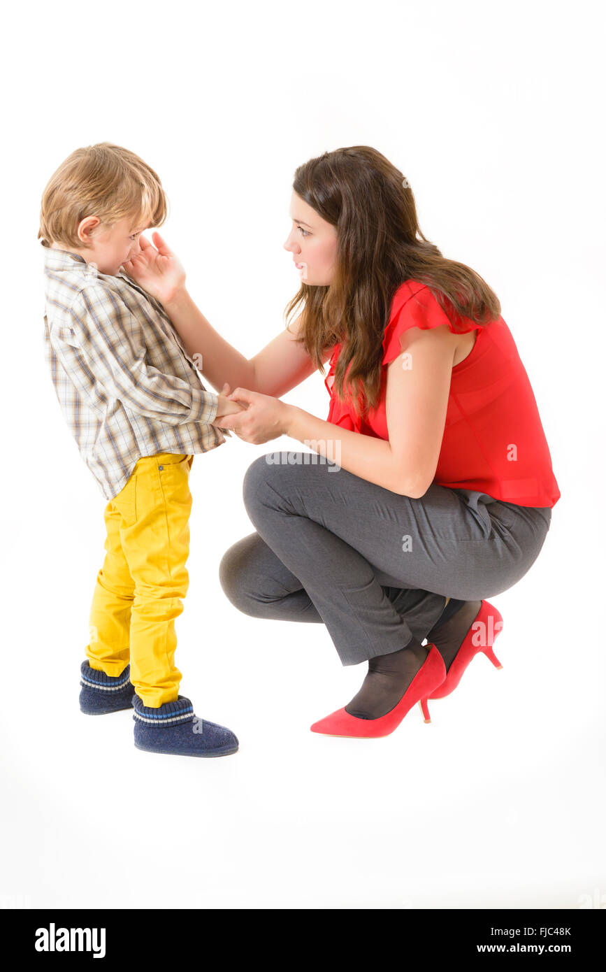 Mother consoling her little boy isolated on white - Stock Image