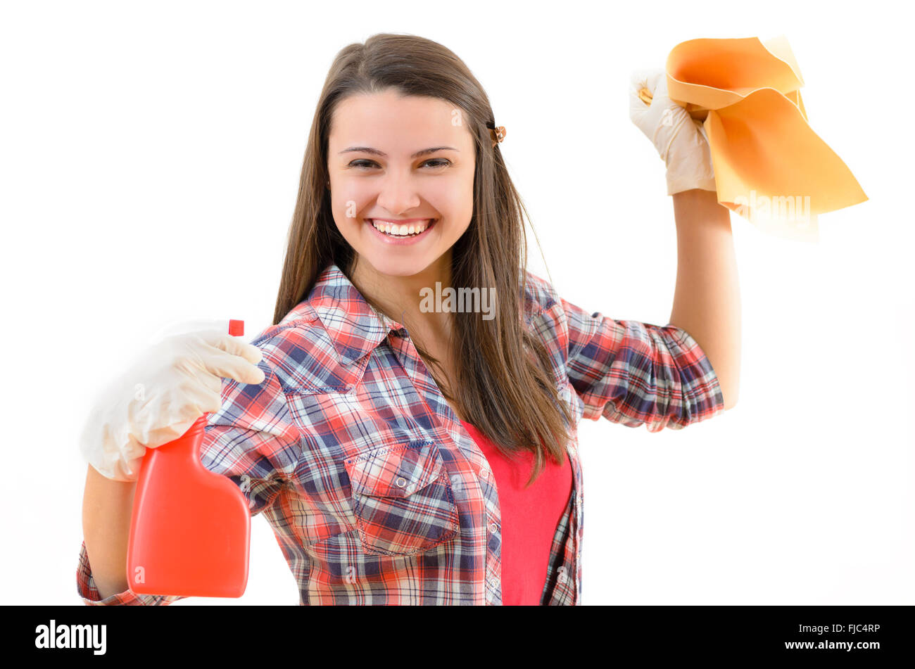 A smiling woman with a cleaning kit in her hands - Stock Image