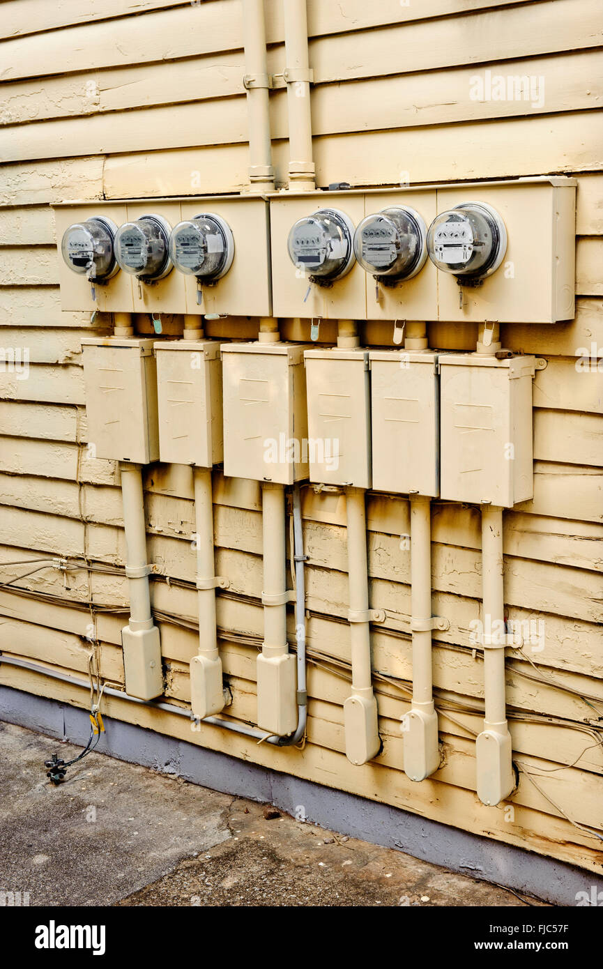 Electric Meters On Side of Old House Converted to Apartments - Stock Image