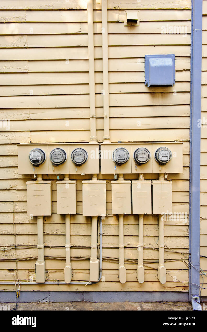 Electric Meters On Side of Old House - Stock Image