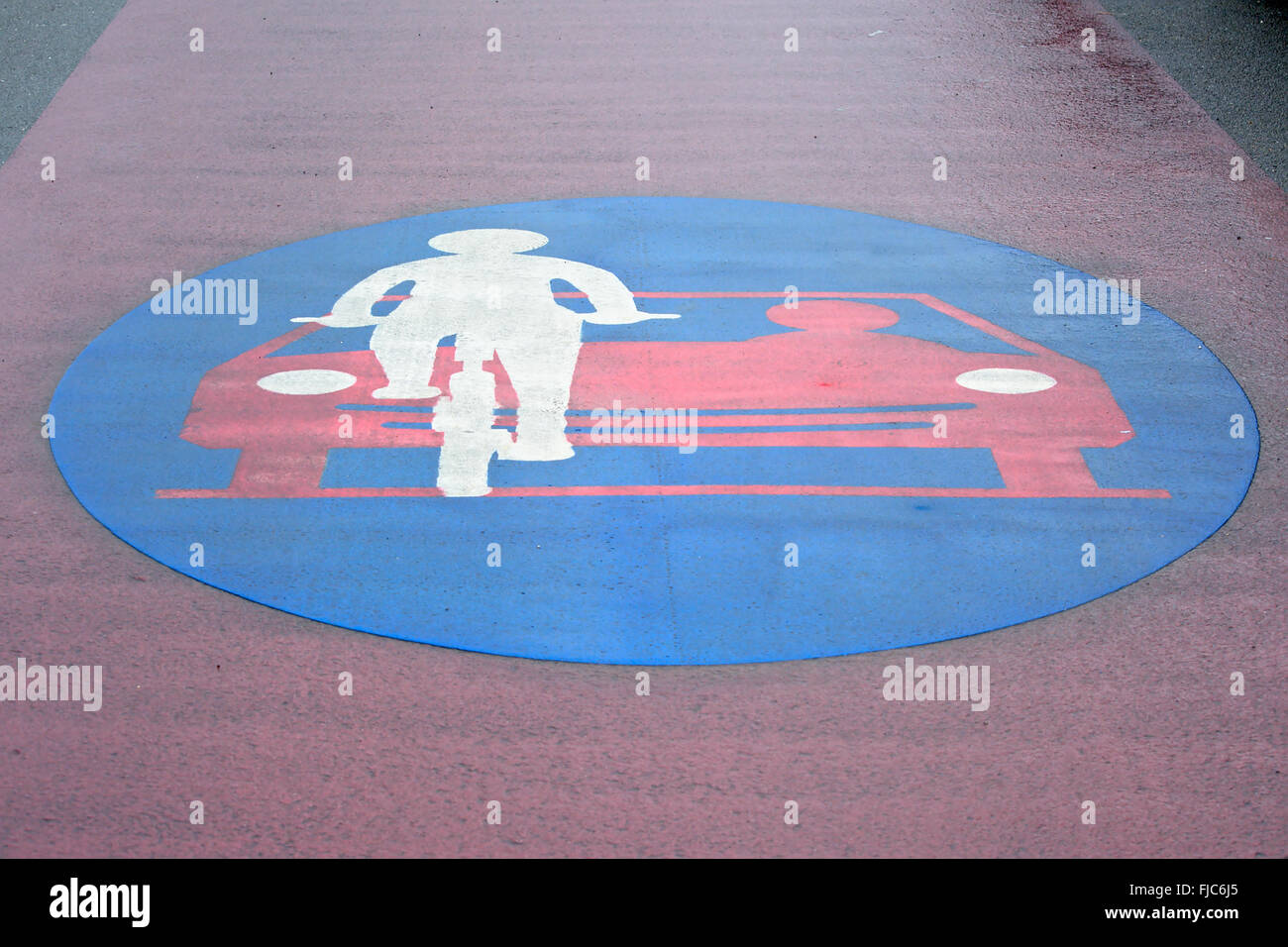 Painted red and blue bicycle priority lane sign - Stock Image