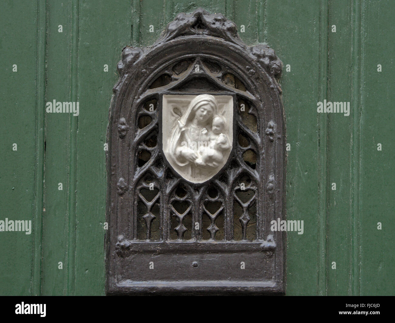 Decorated door viewer with bas-relief of virgin mary with baby jesus, found at ter hoyen beguinage in Ghent - Stock Image