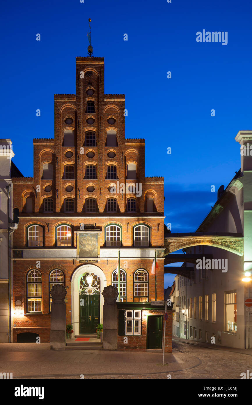 House of the Schiffergesellschaft, now restaurant at night, Lübeck, Schleswig-Holstein, Germany - Stock Image
