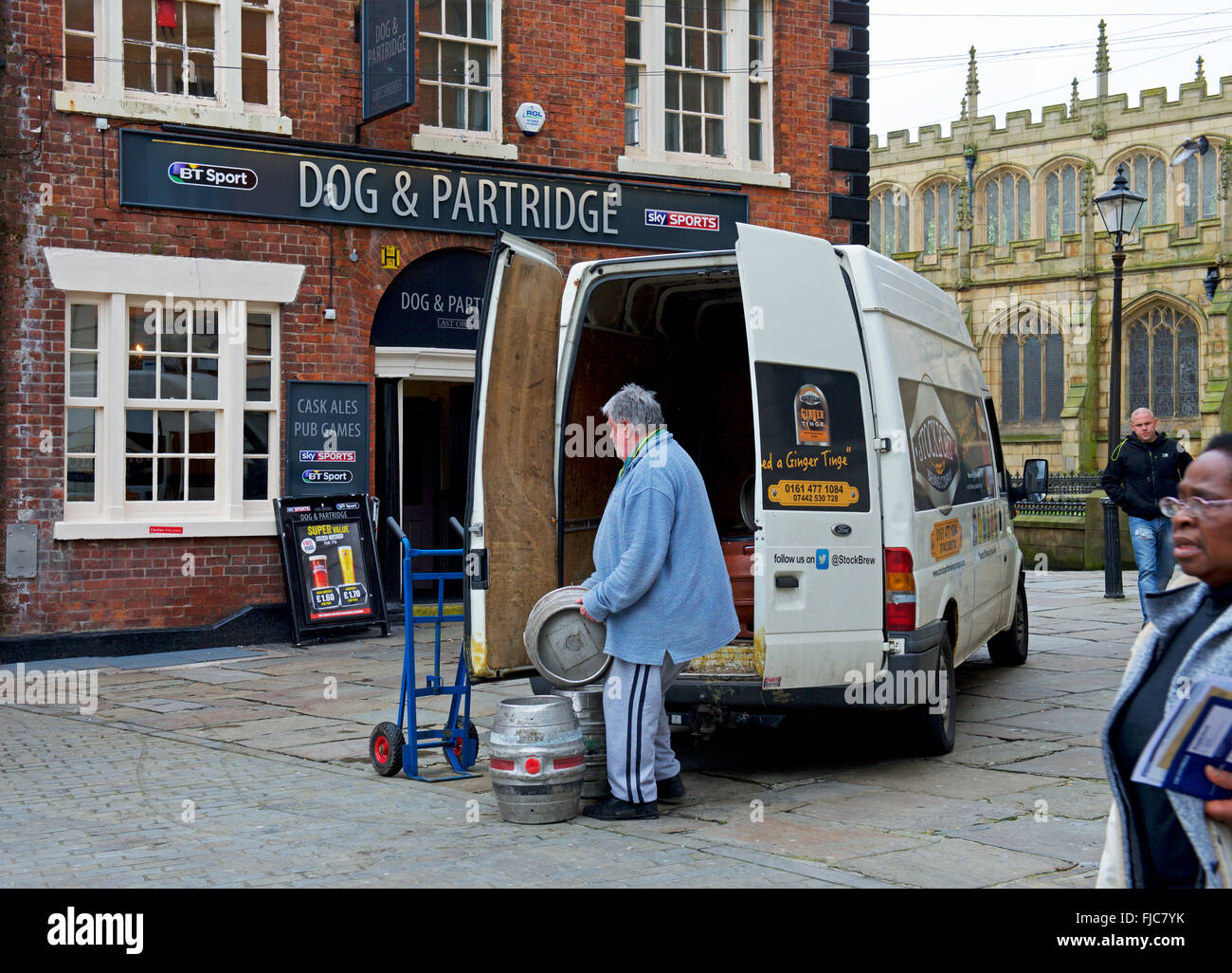 Delivering barrels of beer to the Dog & Partridge pub in Wigan, Lancashire, England UK - Stock Image