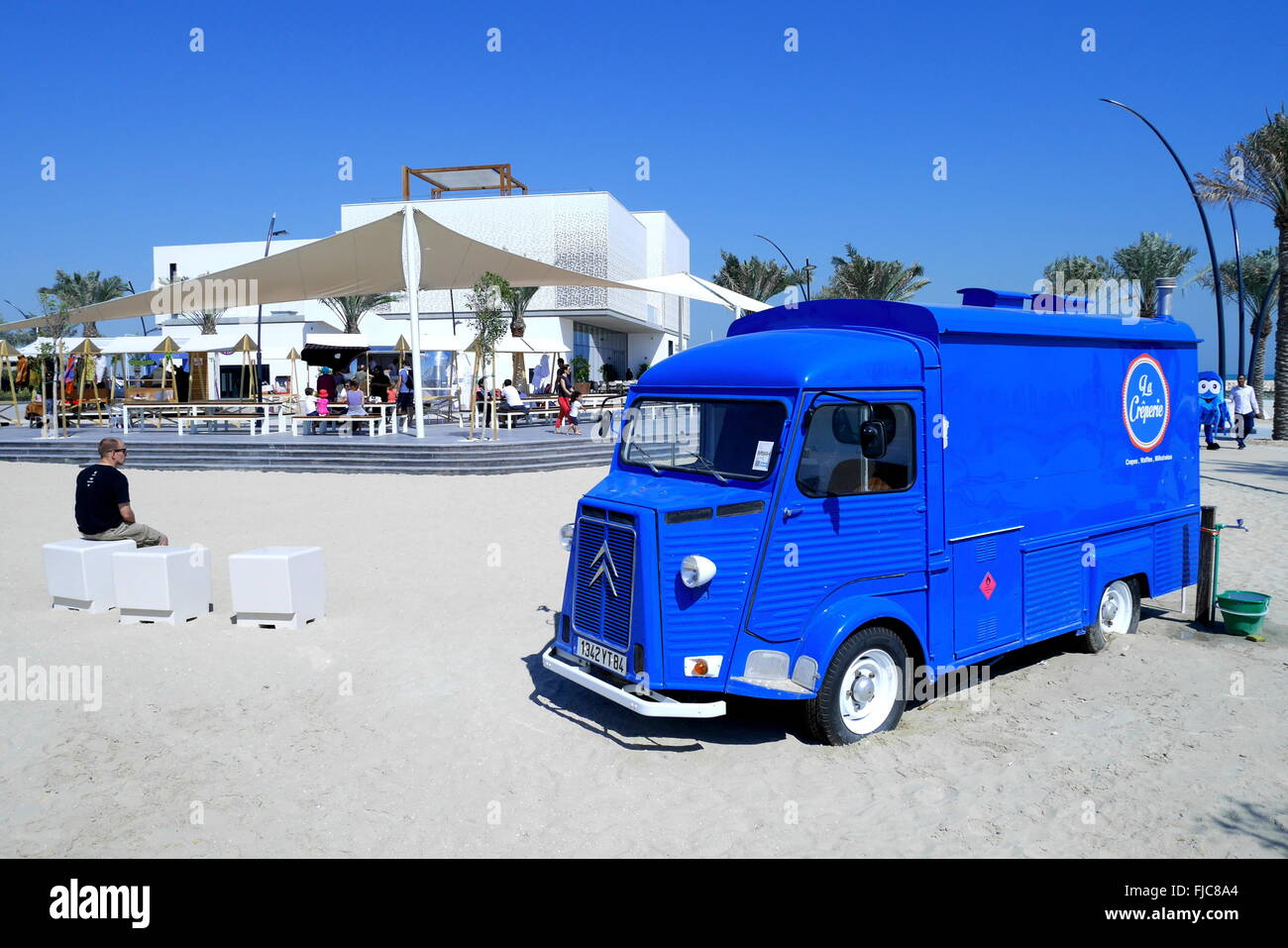 Citroen van selling pancakes in front of the marketing pavilion for the Marassi al Bahrain residential and retail - Stock Image