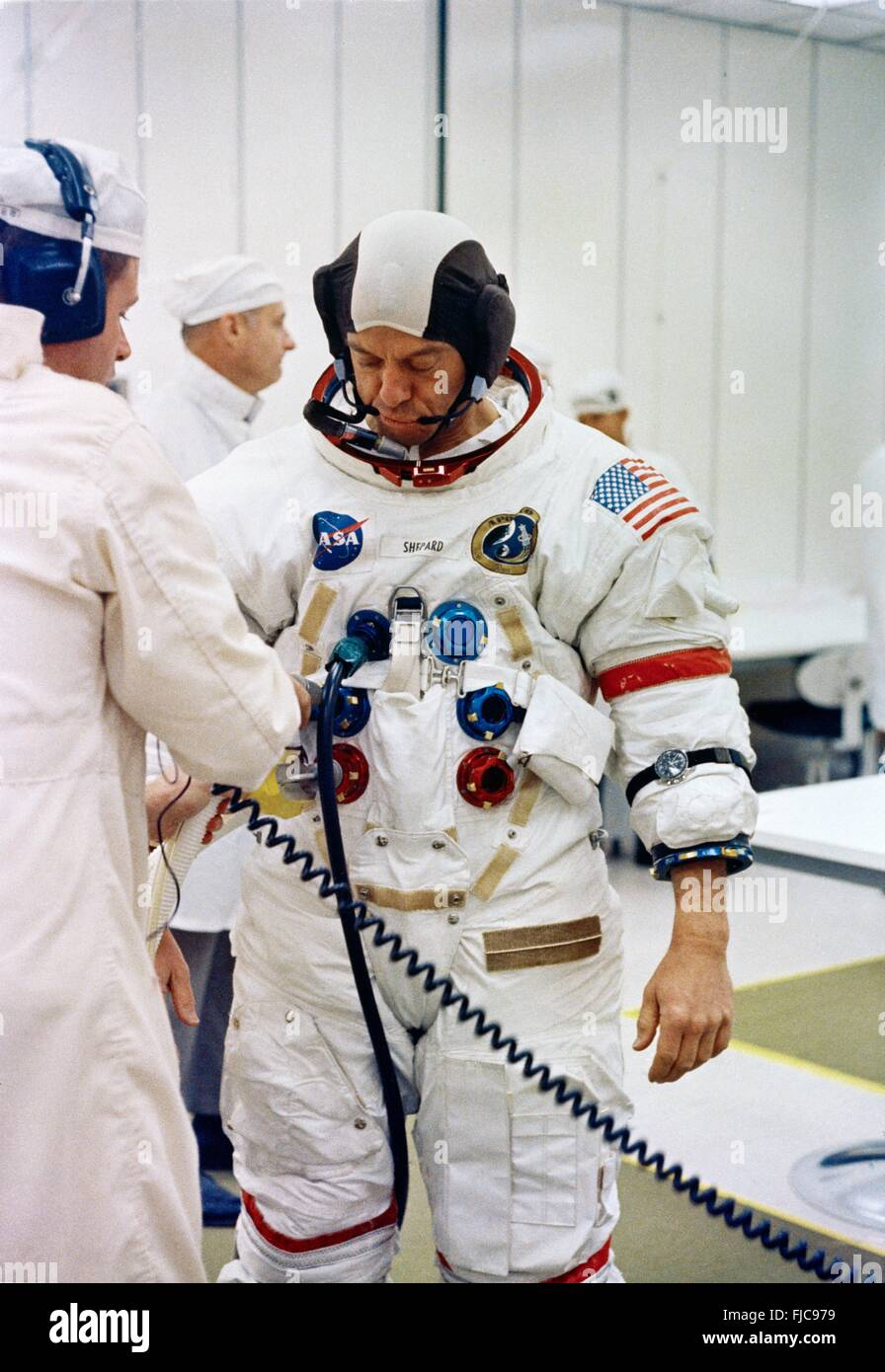 NASA Apollo 14 astronaut Commander Alan B. Shepard Jr., is assisted in putting on his spacesuit at the Kennedy Space - Stock Image