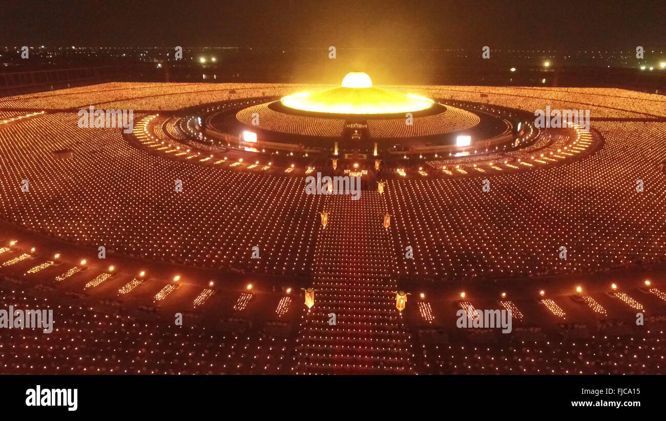Thai Buddhists And Devotees Take Part In A Candle Lighting Ceremony At Wat  Phra Dhammakaya In