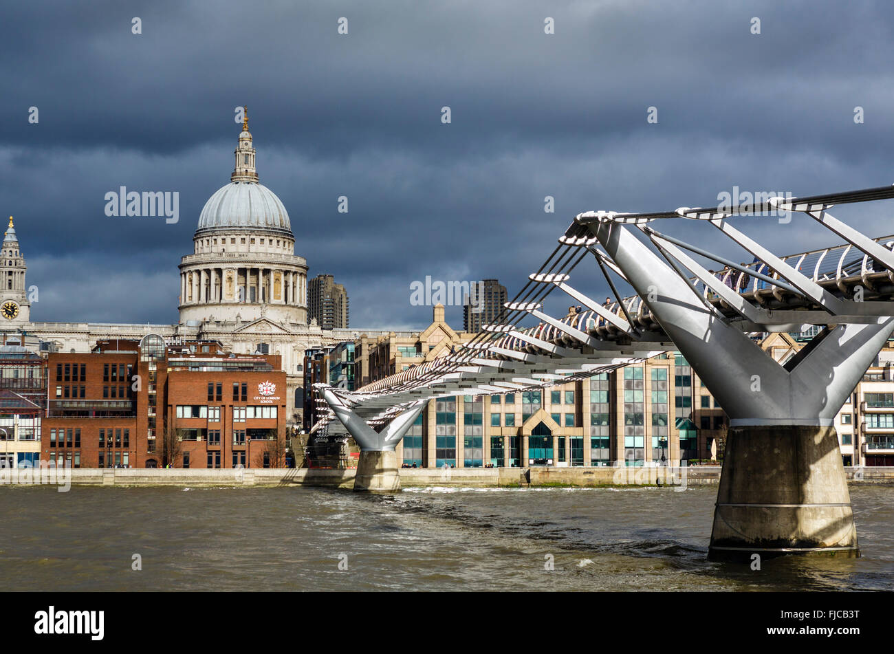 View of Millennium Bridge and River Thames looking towards St Paul's Cathedral, London, England, UK - Stock Image