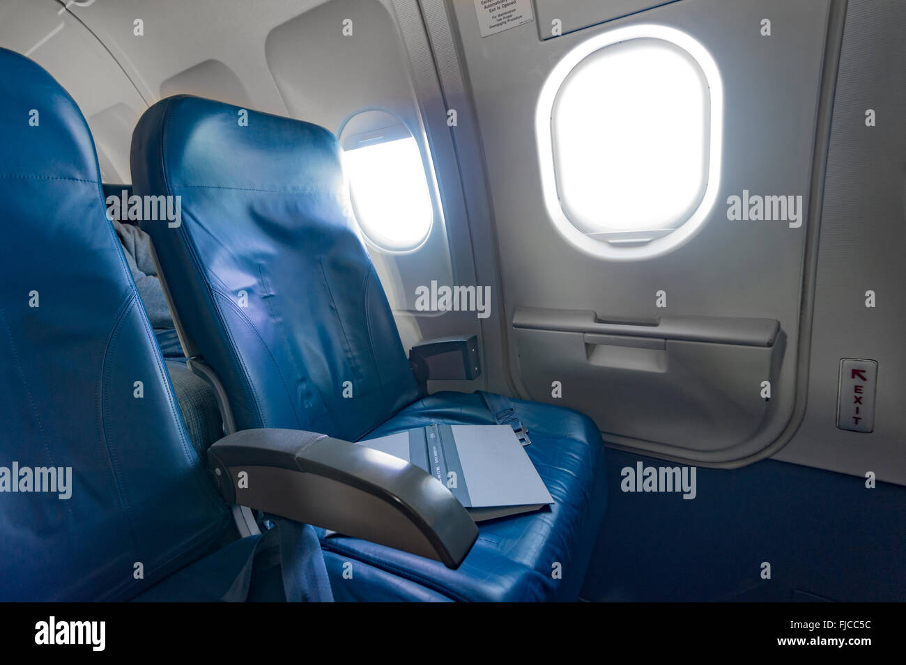 Airplane Seat With Book - Stock Image