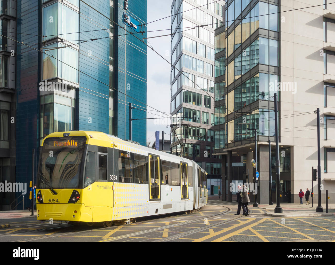 Tram passing Double Tree Hilton hotel, One Piccadilly Place, 1 Auburn Street., Manchester, United Kingdom - Stock Image