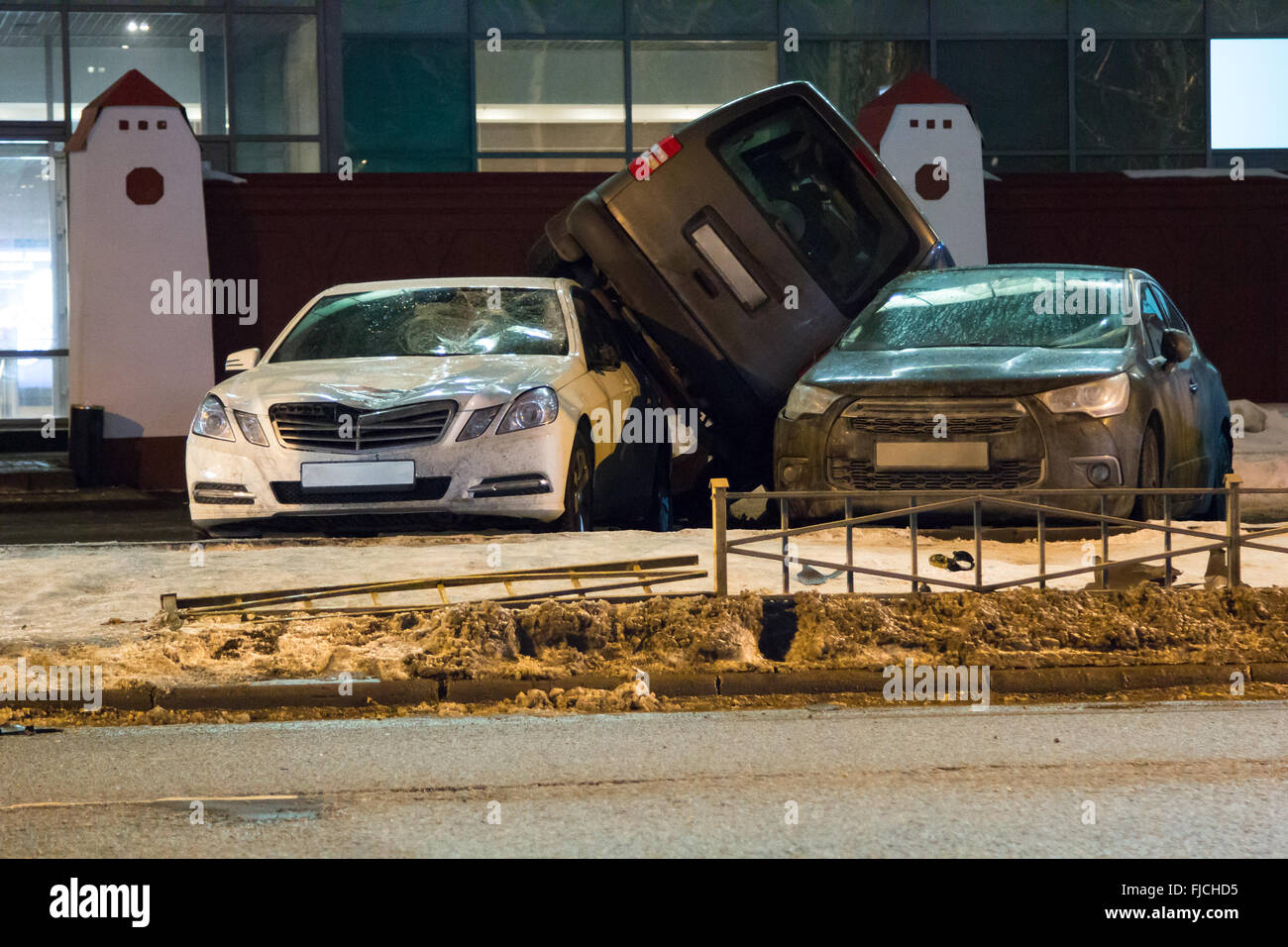 car parked on the roof of the other two - Stock Image