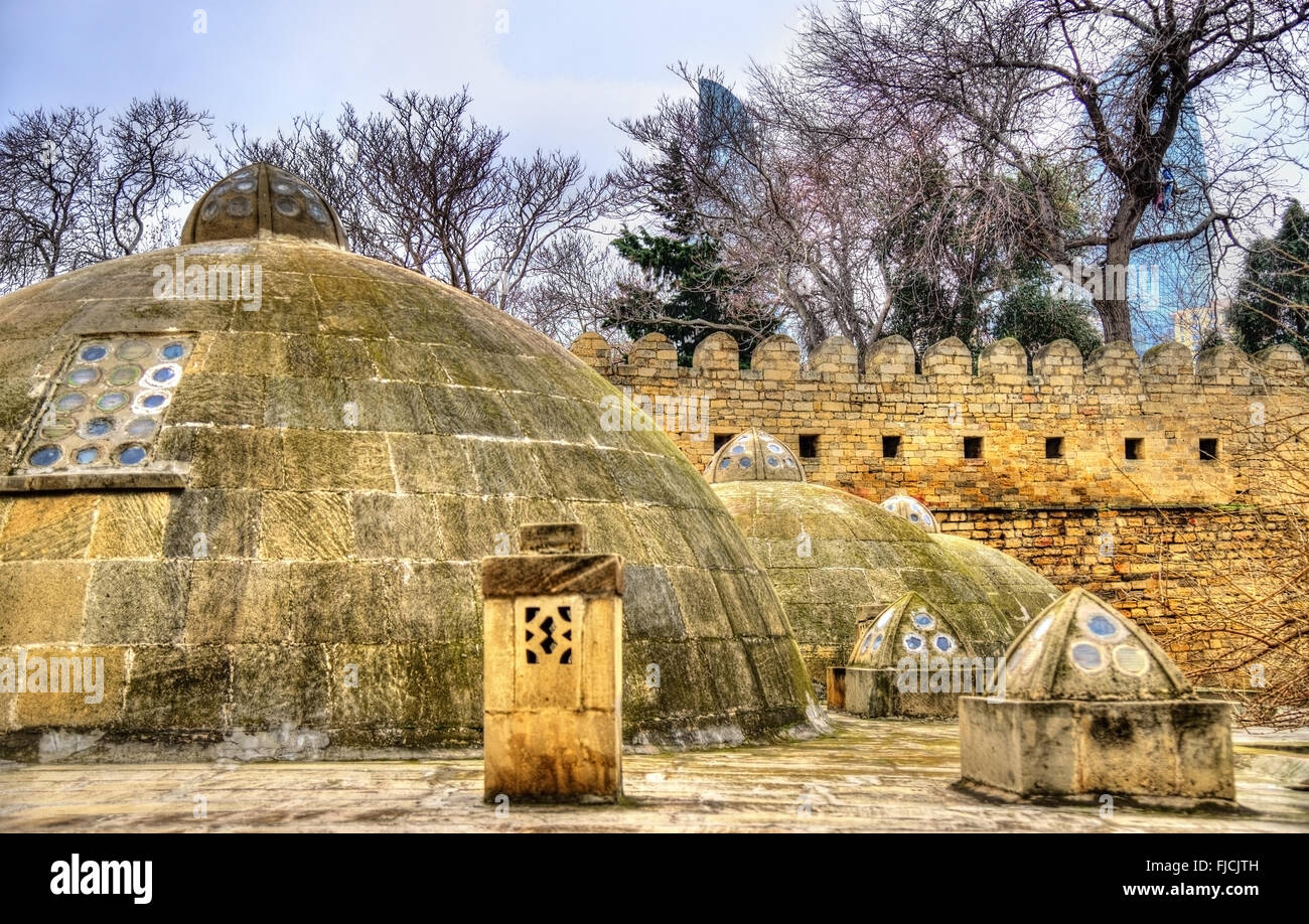 Round roofs of ancient public baths in Baku - Stock Image