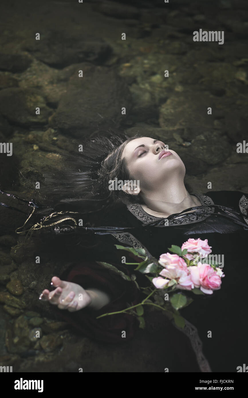Beautiful drown woman in a river . Ophelia concept - Stock Image