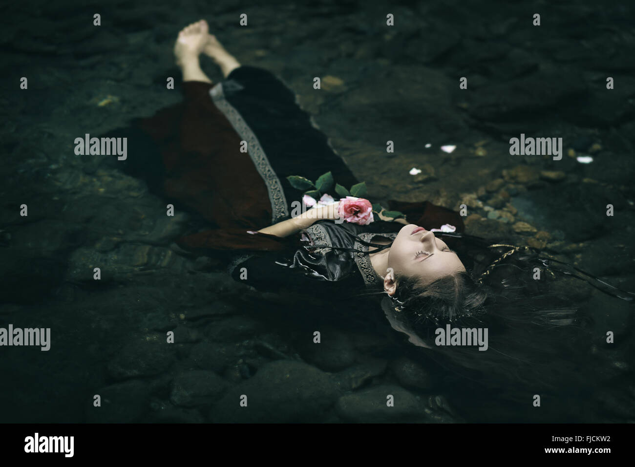 Beautiful floating dead woman in water . Ophelia conceptual - Stock Image