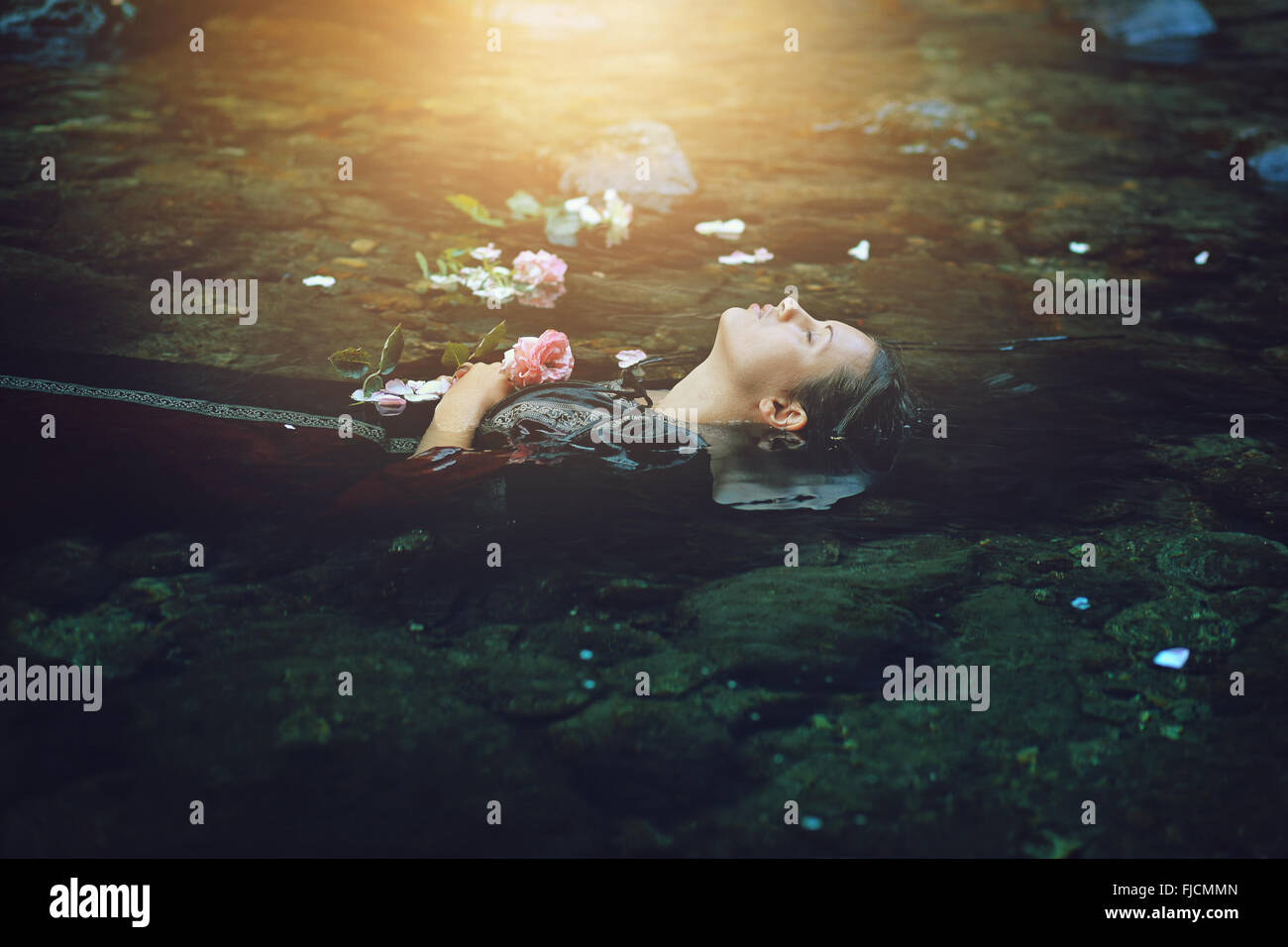 Floating dead woman in dark river . Ophelia conceptual - Stock Image