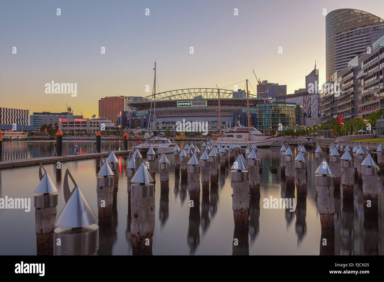 Melbourne, Australia - Feb 21 2016: Etihad Stadium viewed from Docklands waterfront with Yachts and bollards - Stock Image