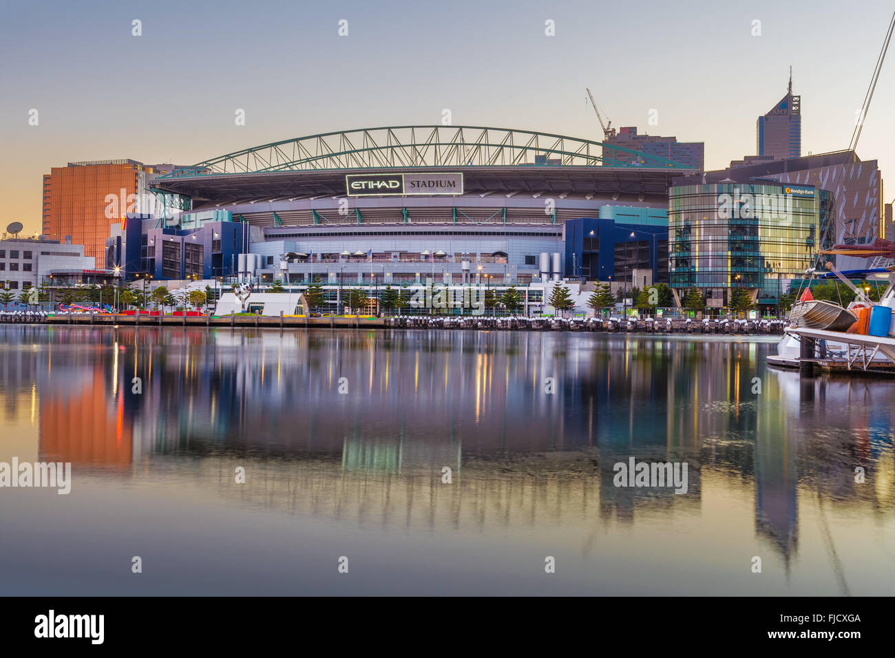 Melbourne, Australia - Feb 21 2016: Etihad Stadium viewed from Docklands waterfront in early morning light - Stock Image